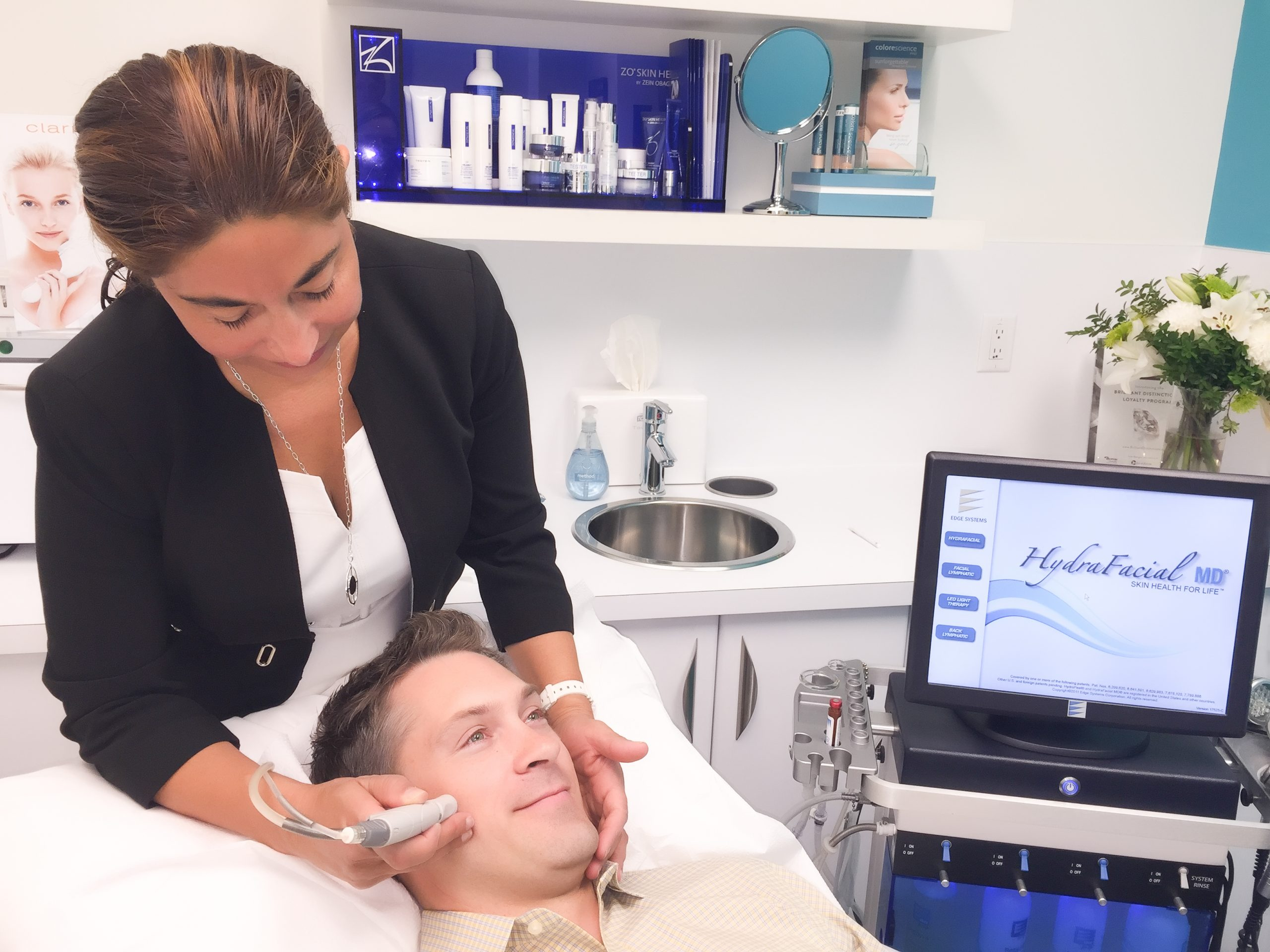 Young male professional receives a HydraFacial at MD Wellness Solutions