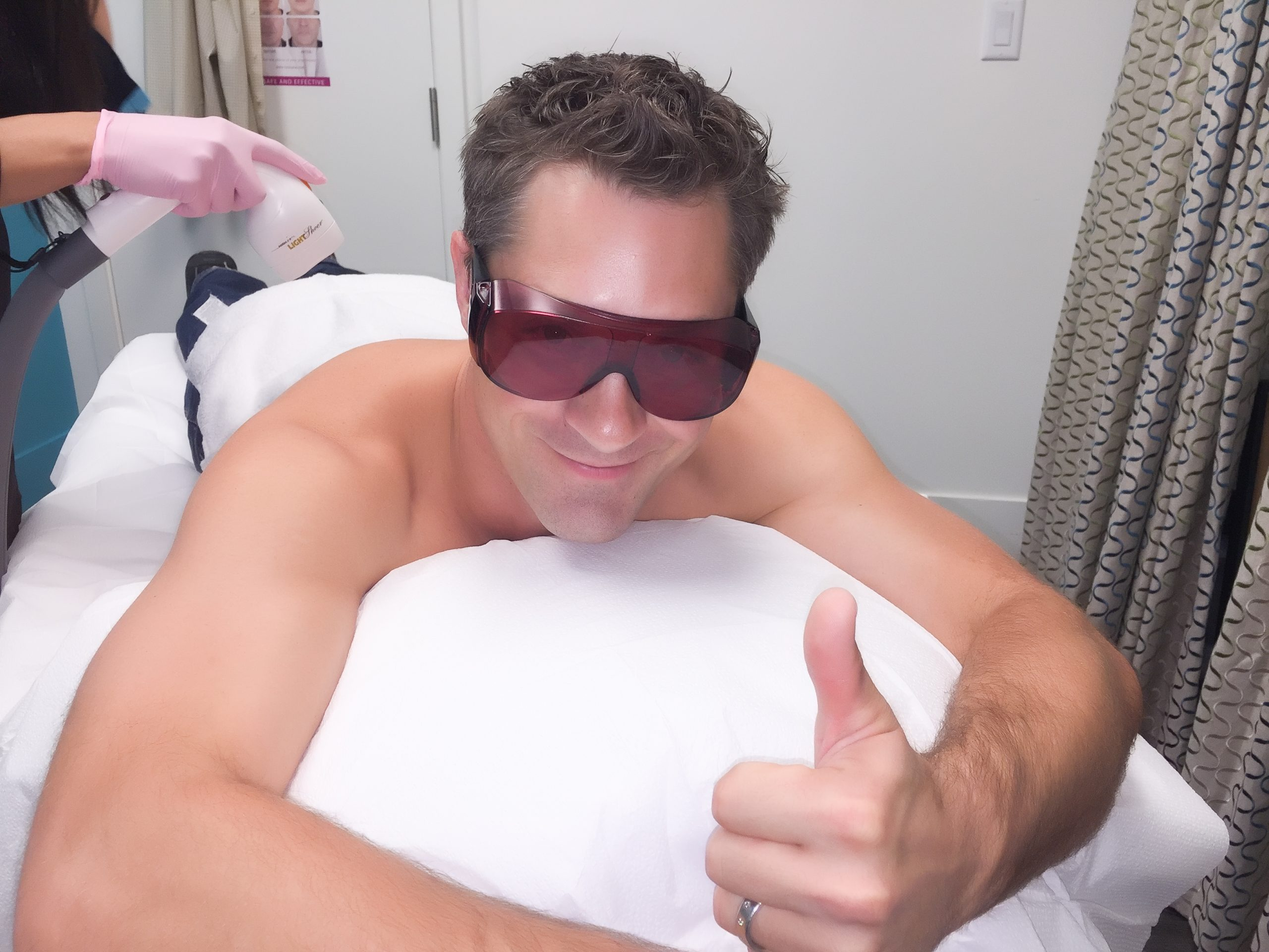 Man receives laser hair removal treatment at MD Wellness Solutions